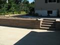 Landscaping retaining wall and concrete sidewalks