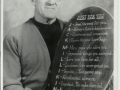 """Jack Millikin with a plaque given to him from """"The Red Barn"""""""